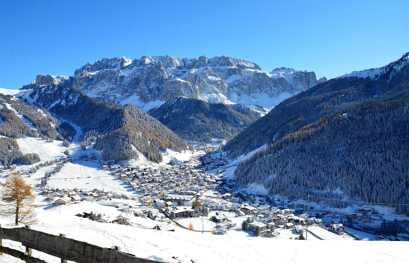 View of the snow-covered village from Chalet Dlaces
