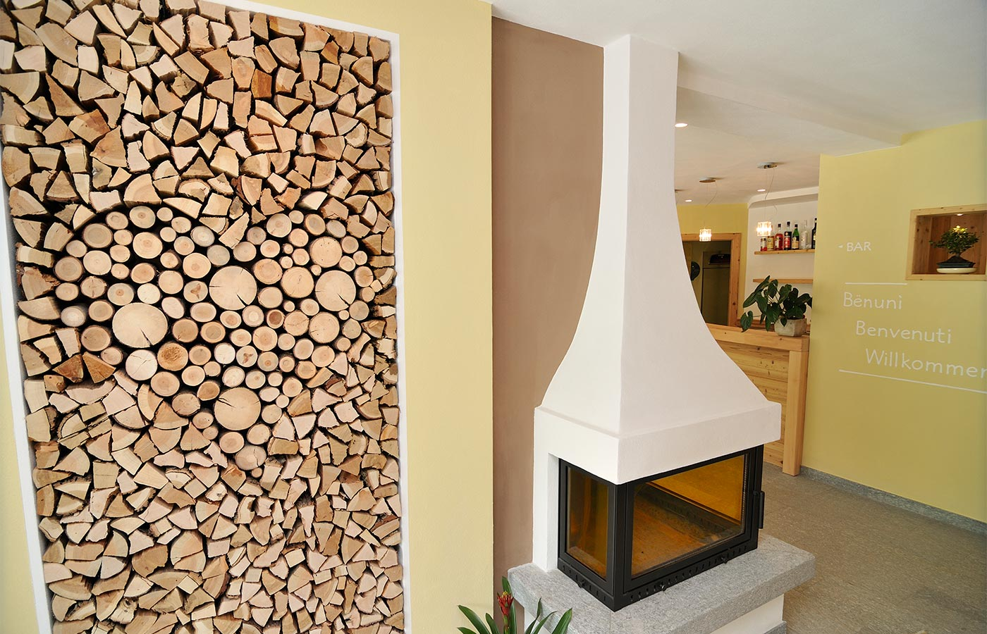 Wall entirely created from wood logs